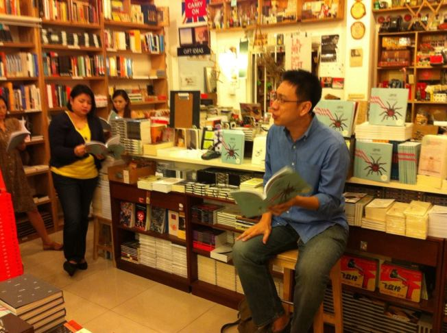 "Alvin Pang performing Chris Mooney-Singh's poem ""Jayawarman 9th Remembers the Dragon Archipelago""."