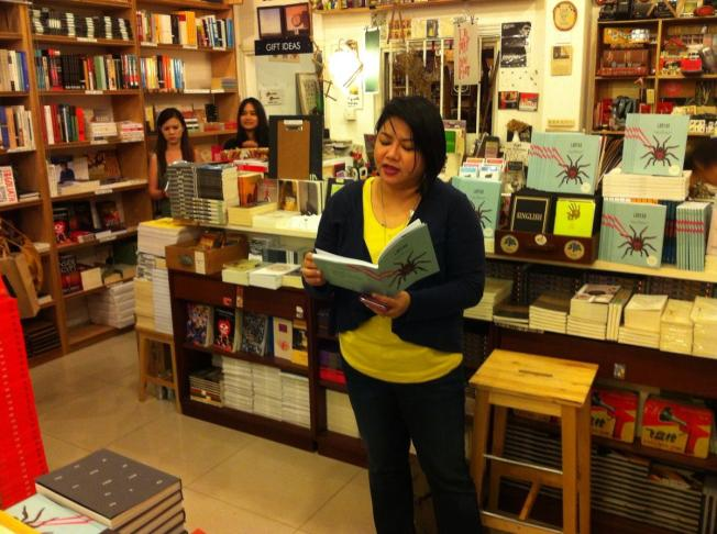 "Patricia Mulles reading Kate Osias's story ""Departures""."